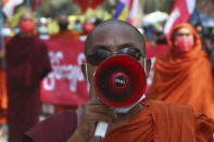 Monks shout slogans during a protest against the Feb. 1 military coup in Mandalay, Myanmar, Saturday, March 6, 2021. The U.N. special envoy for Myanmar on Friday called for urgent Security Council action, saying about 50 peaceful protesters were killed and scores were injured in the military's worst crackdowns this week. (AP Photo)