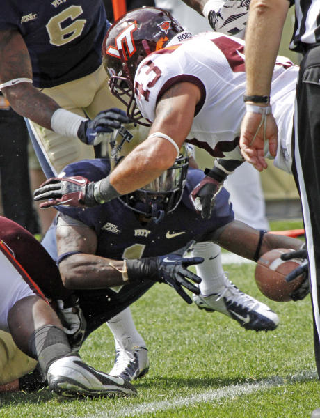 Pittsburgh running back Ray Graham, bottom, reaches under Virginia Tech linebacker Jeron Gouveia-Winslow (43) to score a touchdown in the second quarter of an NCAA college football game, Saturday, Sept. 15, 2012 in Pittsburgh. (AP Photo/Keith Srakocic)