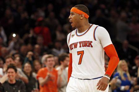Feb 12, 2017; New York, NY, USA; New York Knicks forward Carmelo Anthony (7) yells to the crowd after hitting a three-point basket during the second half against the San Antonio Spurs at Madison Square Garden. Mandatory Credit: Adam Hunger-USA TODAY Sports