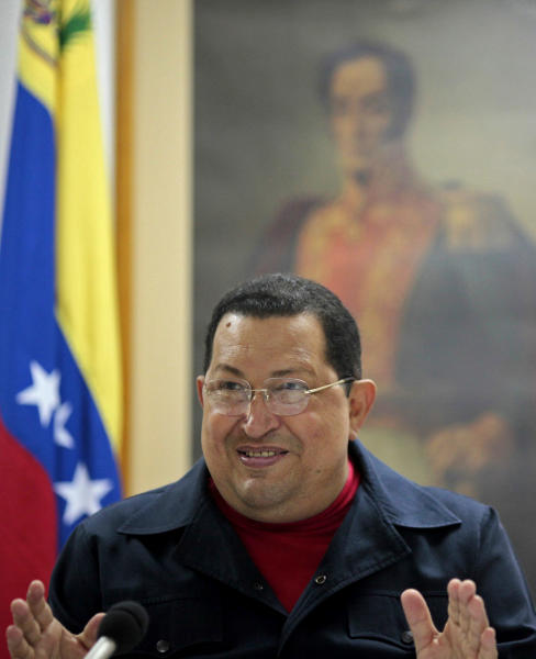 In this photo released by Miraflores Press Office Sunday March 4, 2012, Venezuela's President Hugo Chavez speaks during a televised speech, backdropped by a framed image of Venezuela's independence hero Simon Bolivar, at an undisclosed location in Havana, Cuba, Saturday March 3, 2012. Chavez appeared Sunday on television for the first time in nine days during which he underwent surgery in Cuba to remove a tumor. Chavez spoke firmly in footage recorded Saturday in Havana. (AP Photo/Miraflores Press Office/Marcelo Garcia)