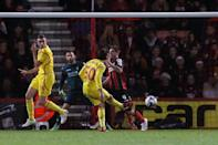 Liverpool's Lazar Markovic, center, scores a goal during the English League Cup soccer quarterfinal match between AFC Bournemouth and Liverpool at Goldsands Stadium, Bournemouth, Wednesday, Dec. 17, 2014. (AP Photo/Tim Ireland)