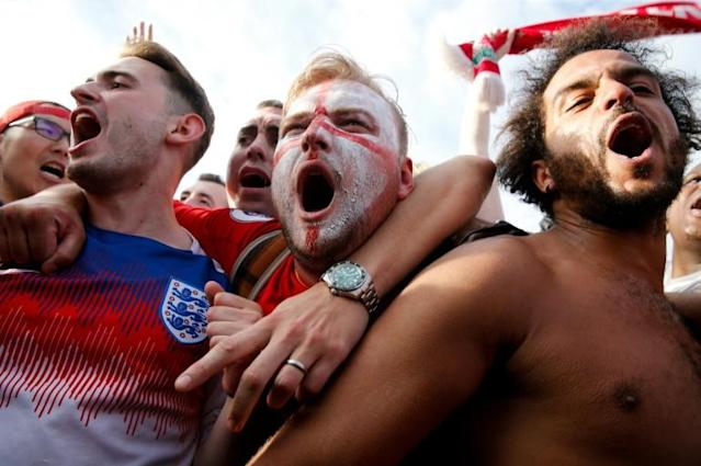 England fans celebrate after their team beat Sweden in the World Cup quarter-finals