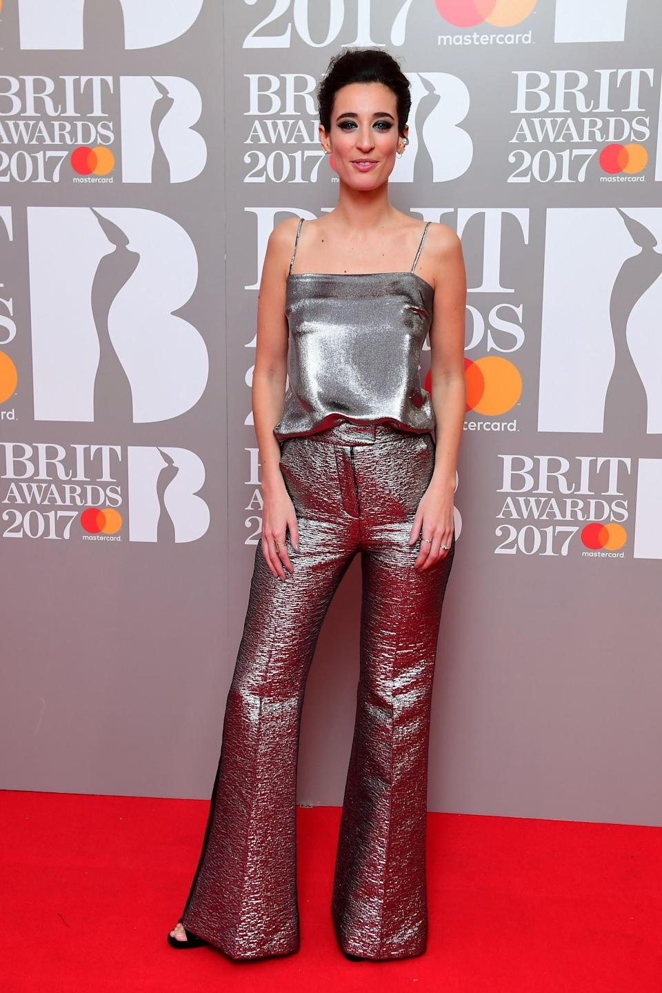 <p>The presenter chose a stand-out silver jumpsuit. <i>[Photo: PA]</i> </p>
