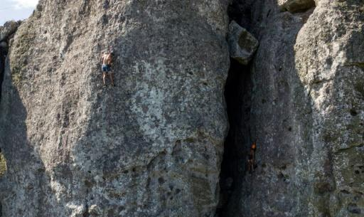 Pablo Veloso (L) climbs the Cerro Arequita outside the city of Minas in Uruguay, where sport climbing is a growing activity