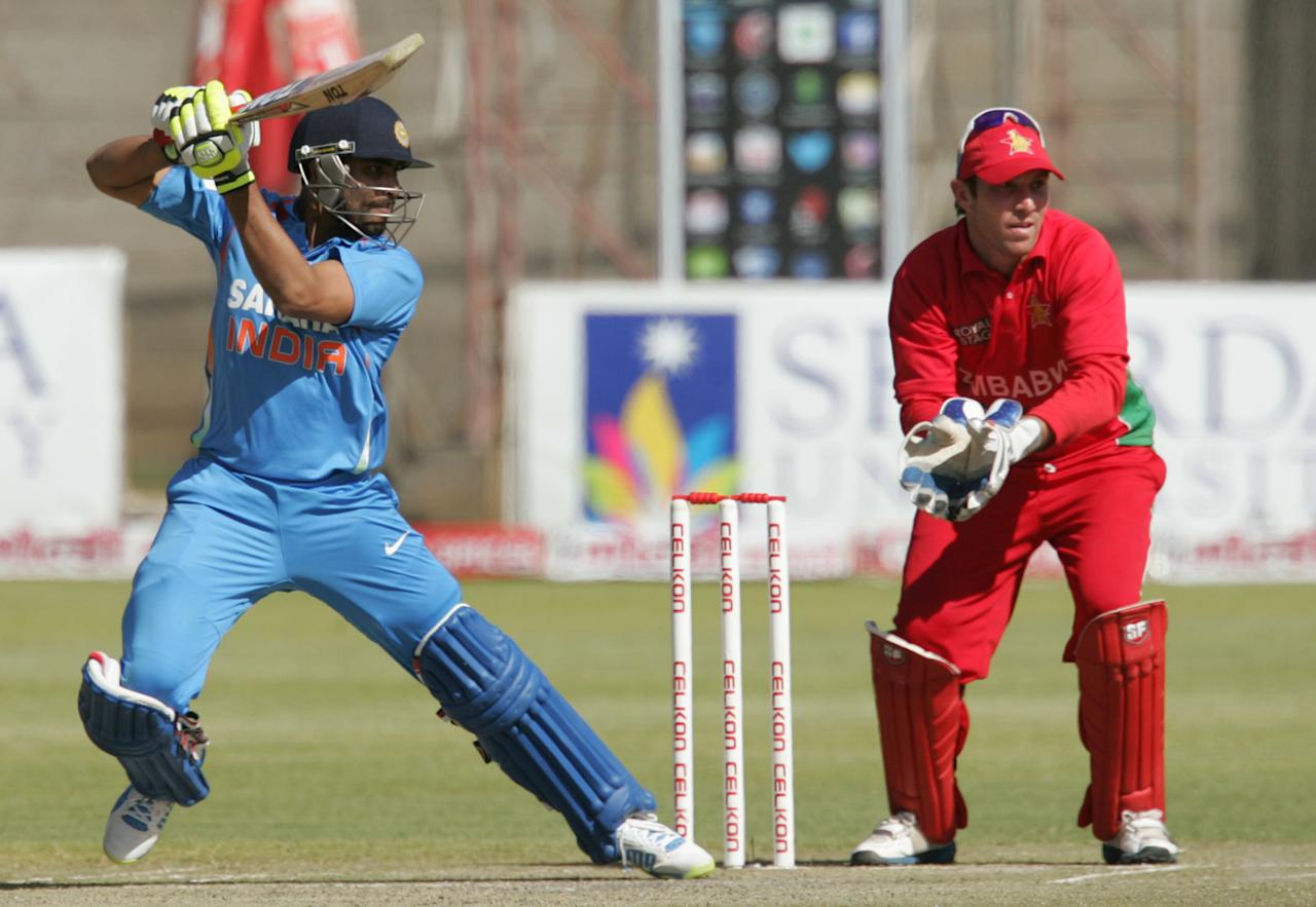 India's Ravindra Jadeja bats as Zimbabwe captain Brendan Taylor watches during the final game of the 5 match cricket ODI series between hosts Zimbabwe and India at Queens Sports Club in Harare on August 3, 2013. AFP PHOTO /Jekesai Njikizana.        (Photo credit should read JEKESAI NJIKIZANA/AFP/Getty Images)