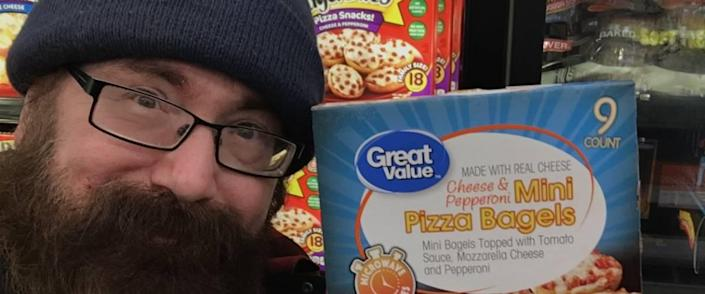 Man poses with Great Value Mini pizza bagels.