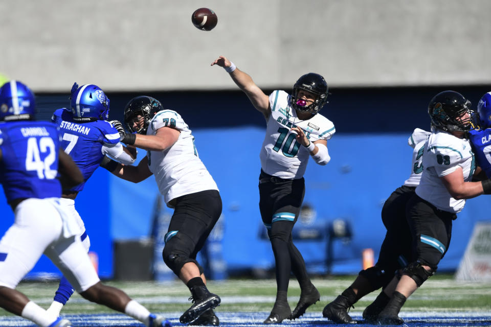 Coastal Carolina quarterback Grayson McCall passes against Georgia State during the second half of an NCAA football game Saturday, Oct. 31, 2020, in Atlanta. Coastal Carolina won 51-0. (AP Photo/John Amis)