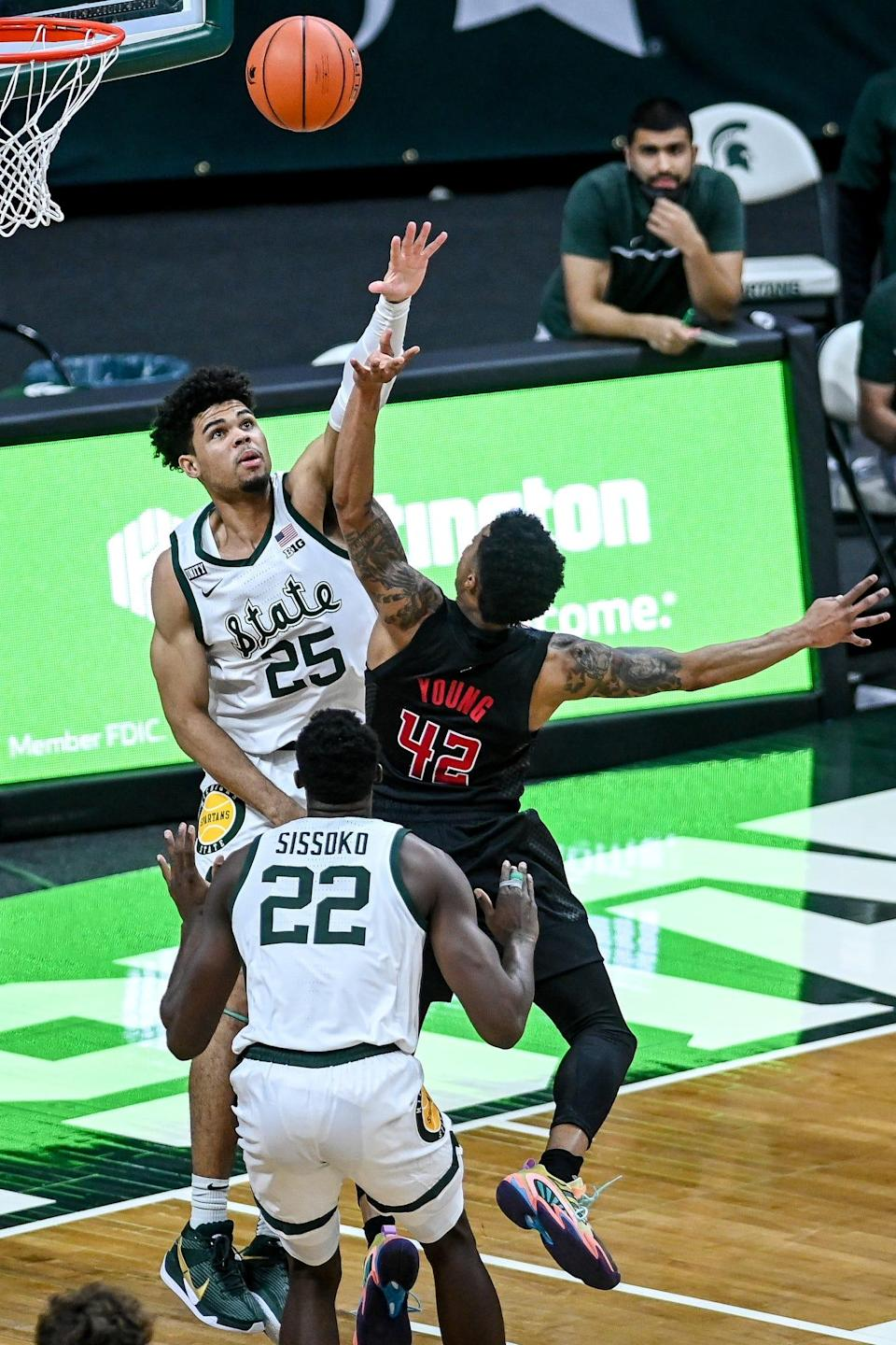 Michigan State's Malik Hall, left, pressures Rutgers' Jacob Young during the first half on Tuesday, Jan. 5, 2021, at the Breslin Center in East Lansing.