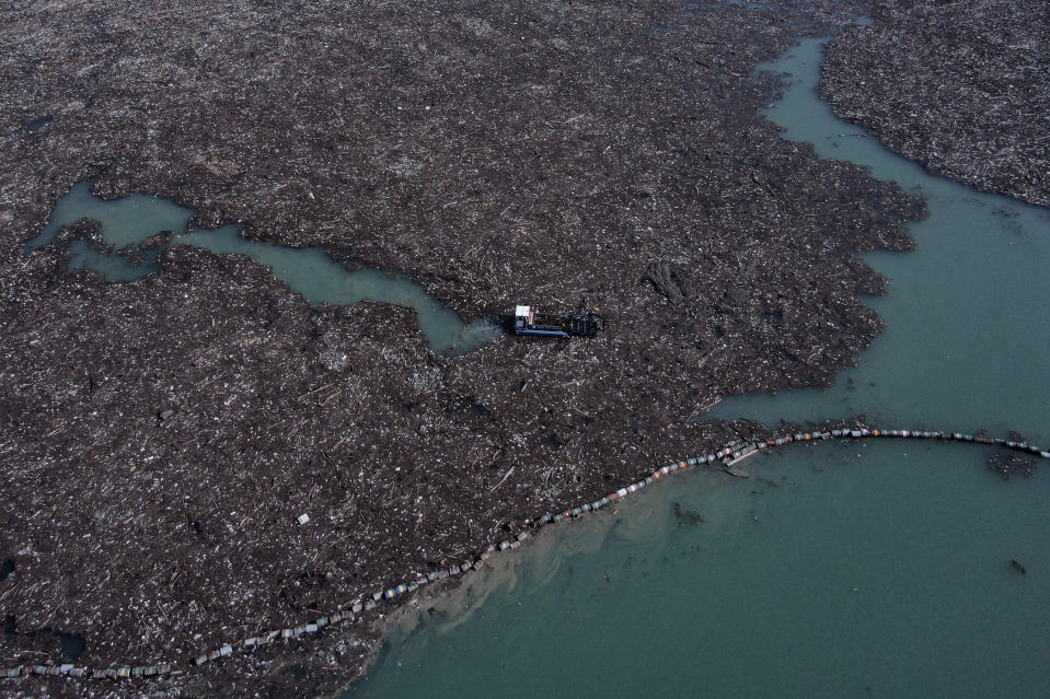 This aerial photo shows garbage floating in the Drina river near Visegrad, eastern Bosnia, Wednesday, Feb. 24, 2021. Environmental activists in Bosnia are warning that tons of garbage floating down the Balkan country's rivers are endangering the local ecosystem and people's health. The Drina River has been covered for weeks with trash that has piled up faster than the authorities can clear it out. (AP Photo/Kemal Softic)