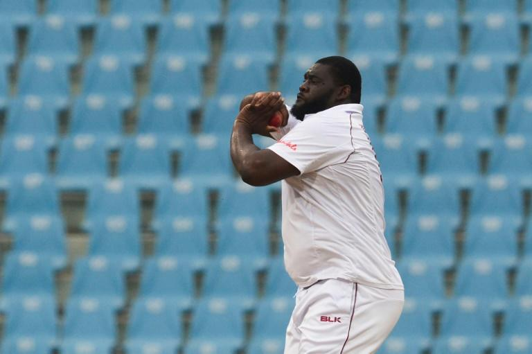Spin to win? West Indies off-spinner Rahkeem Cornwall, in action against Afghanistan in November, could be selected for Friday's third Test against England at Old Trafford    delivers a ball during the third day of the only cricket Test match between Afghanistan and West Indies at the Ekana Cricket Stadium in Lucknow on November 29, 2019
