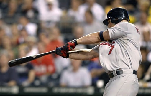 St. Louis Cardinals' Matt Holliday (7) hits a solo home run in the sixth inning of the baseball game against the Pittsburgh Pirates on Monday, Aug. 27, 2012, in Pittsburgh. (AP Photo/Keith Srakocic)