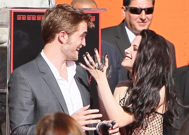 Kristen threatened Rob with her dirty fingers. Do it!