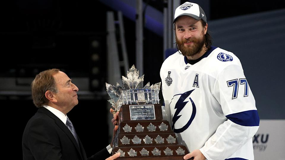 EDMONTON, ALBERTA - SEPTEMBER 28: NHL Commissioner Gary Bettman presents the Conn Smythe Trophy to Victor Hedman #77 of the Tampa Bay Lightning after Game Six of the NHL Stanley Cup Final between the Tampa Bay Lightning and the Dallas Stars at Rogers Place on September 28, 2020 in Edmonton, Alberta, Canada. (Photo by Dave Sandford/NHLI via Getty Images)