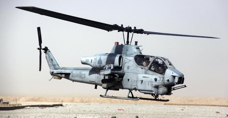 """This undated image provided by the US Marines shows a AH-1W """"Cobra"""" helicopter. Seven Marines were killed in a collision of two helicopters, one of them similar to this one, near Yuma, Ariz., during night training exercises, Wednesday, Feb. 22, 2012. Lt. Maureen Dooley with Miramar Air Base in California said the service members with the 3rd Marine Aircraft Wing were based at Camp Pendleton north of San Diego. The crash involved an AH-1W """"Cobra"""" and UH-1 """"Huey"""" helicopter. (AP Photo/US Marines)"""
