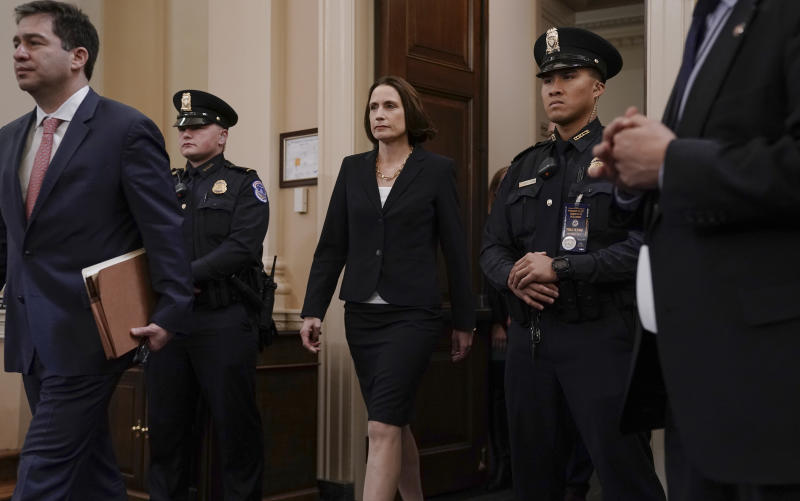 Former White House national security aide Fiona Hill returns from a break to testify before the House Intelligence Committee on Capitol Hill in Washington, Thursday, Nov. 21, 2019, during a public impeachment hearing of President Donald Trump's efforts to tie U.S. aid for Ukraine to investigations of his political opponents. (AP Photo/J. Scott Applewhite)