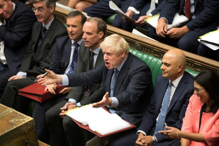 Johnson gestured angrily during clashes in parliament with opposition leader Jeremy Corbyn (AFP Photo/JESSICA TAYLOR)