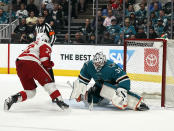 Detroit Red Wings center Andreas Athanasiou (72) scores a goal past San Jose Sharks goaltender Martin Jones (31) during the second period of an NHL hockey game Monday, March 25, 2019, in San Jose, Calif. (AP Photo/Tony Avelar)