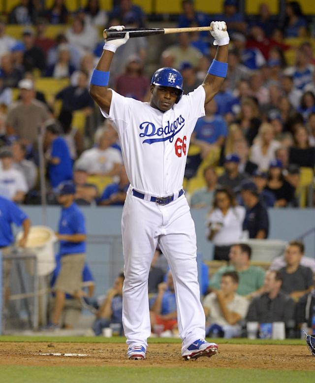 Los Angeles Dodgers' Yasiel Puig reacts after fouling out during the seventh inning of their baseball game against the Chicago Cubs, Tuesday, Aug. 27, 2013, in Los Angeles. (AP Photo/Mark J. Terrill)