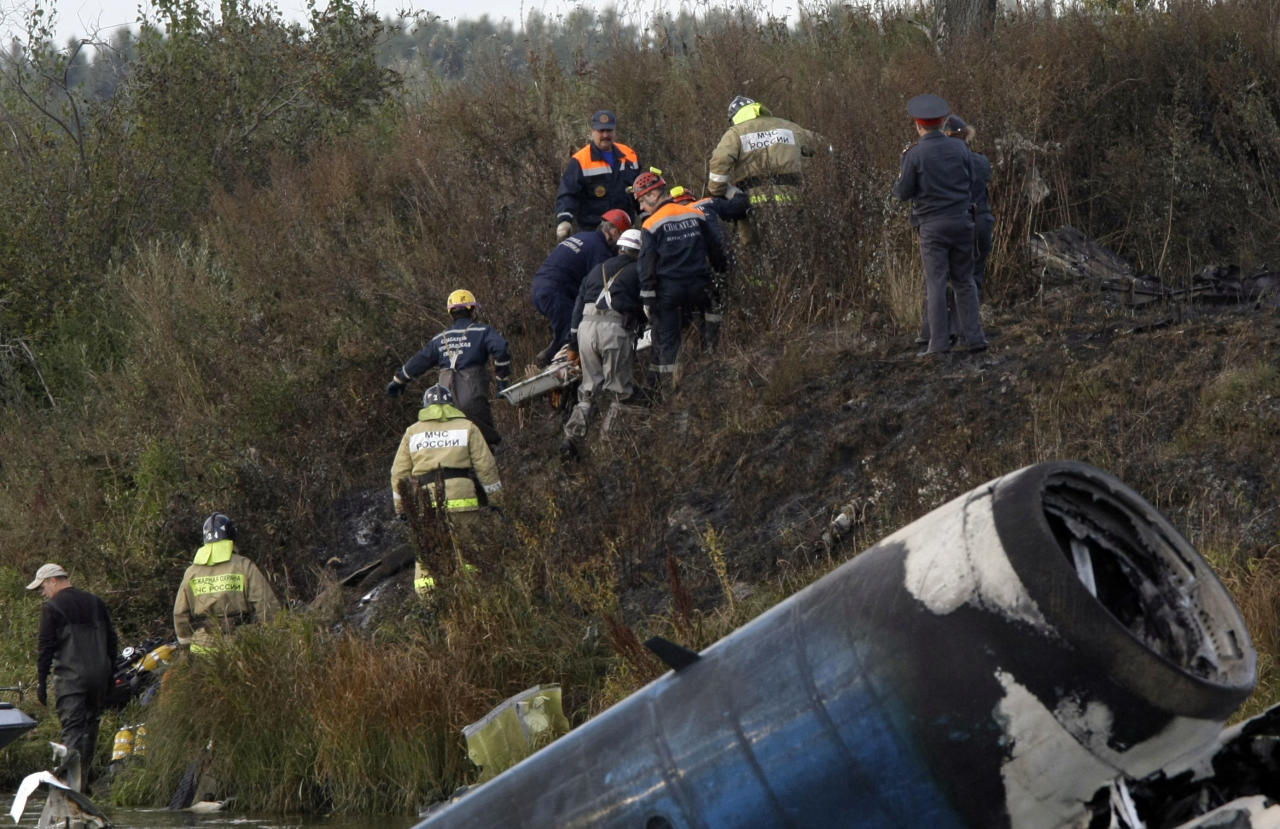 Rescuers lift a stretcher with the body of a victim out of the river at the crash site of the Russian Yak-42 jet near the city of Yaroslavl, on the Volga River about 150 miles (240 kilometers) northeast of Moscow, Russia, Wednesday, Sept. 7, 2011. The Yak-42 jet carrying a top ice hockey team crashed while taking off Wednesday in western Russia. The Russian Emergency Situations Ministry said the plane was carrying the Lokomotiv ice hockey team. (AP Photo/Misha Japaridze)