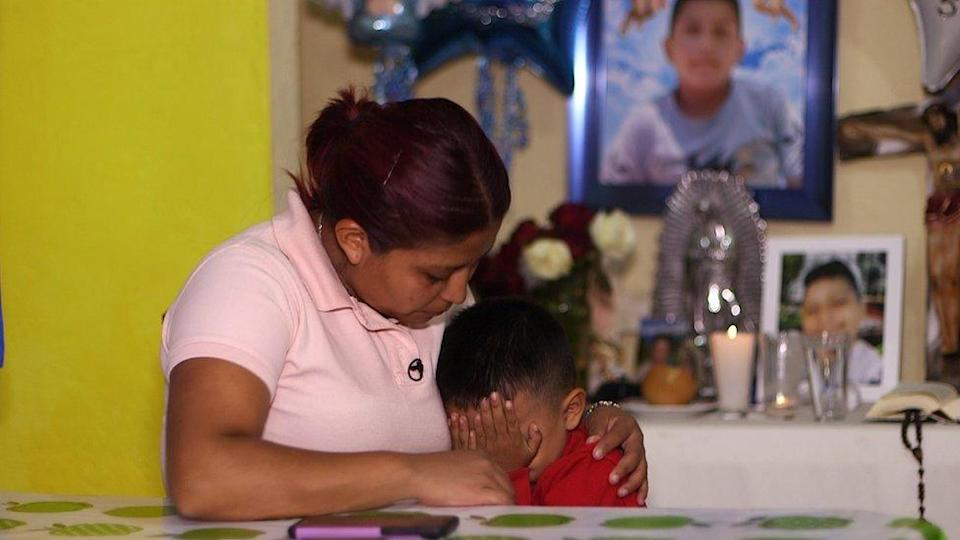 Marisol Tapia comforting her younger son
