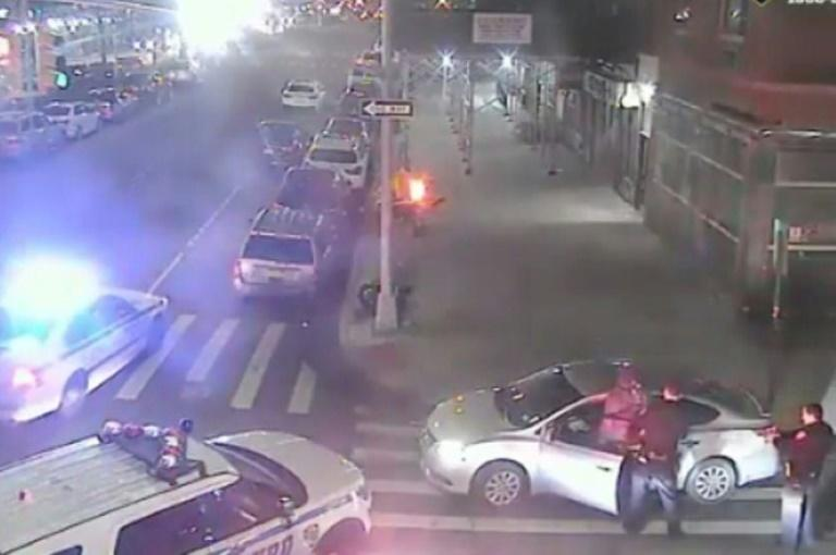 This surveillance video screen grab shows police officers taking into custody the suspect in the Hanukkah stabbings (AFP Photo/Handout)
