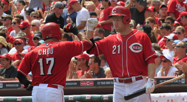Cincinnati Reds Shin-Soo Choo gets congratulated by teammate Todd Frazier after scoring in the first inning in their baseball game against the St. Louis Cardinals in Cincinnati, Monday Sept. 2, 2013. (AP Photo/Tom Uhlman)