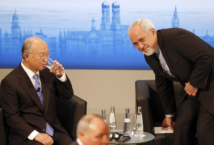 Iran's Foreign Minister Mohammad Javad Zarif, right, takes a seat next to Director General of the International Atomic Energy Agency, IAEA, Yukiya Amano, prior to a panel discussion at the 50th Security Conference on security policy in Munich, Germany, Sunday, Feb. 2, 2014. (AP Photo/Frank Augstein)