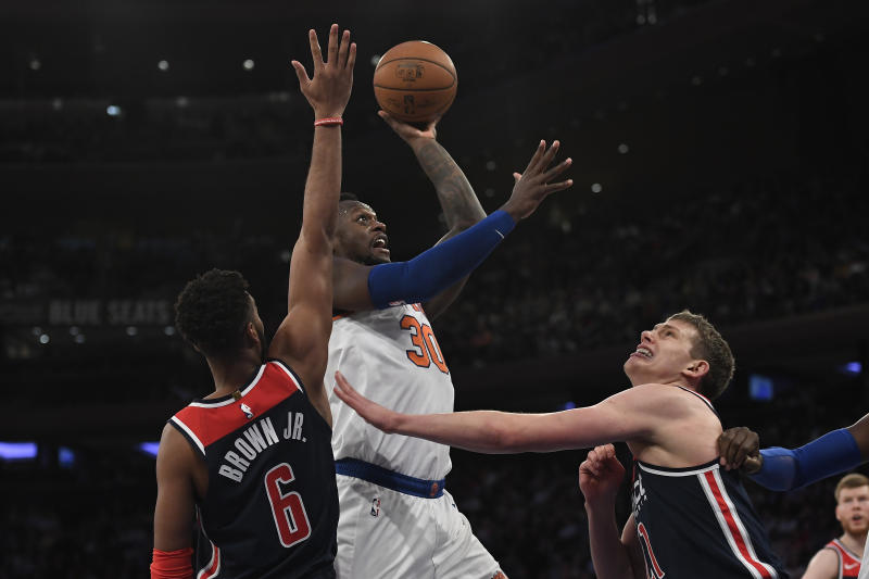 New York Knicks forward Julius Randle (30) attempts a basket as Washington Wizards forward Troy Brown Jr. (6) and forward Moritz Wagner (21) defend during the second half of an NBA basketball game, Wednesday, Feb. 12, 2020, in New York. The Wizards won 114-96. (AP Photo/Sarah Stier)