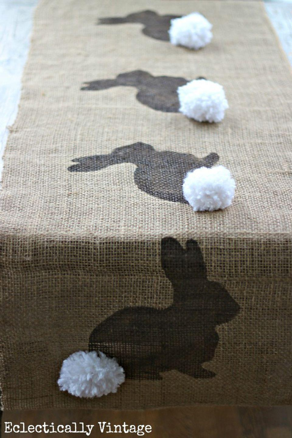 "<p>Delight your friends and family this Easter with this adorable piece for your holiday table. <br><strong>Get the tutorial at <a href=""http://www.kellyelko.com/2013/03/burlap-bunny-table-runner/"" rel=""nofollow noopener"" target=""_blank"" data-ylk=""slk:Kelly Elko"" class=""link rapid-noclick-resp"">Kelly Elko</a>.<br></strong></p><p><a class=""link rapid-noclick-resp"" href=""https://www.amazon.com/FELIZEST-Weddings-Table-Runners-Decorations-Decorate/dp/B07YNMPBM7/ref=sr_1_2_sspa?tag=syn-yahoo-20&ascsubtag=%5Bartid%7C10050.g.1652%5Bsrc%7Cyahoo-us"" rel=""nofollow noopener"" target=""_blank"" data-ylk=""slk:SHOP BURLAP RUNNER"">SHOP BURLAP RUNNER</a></p>"