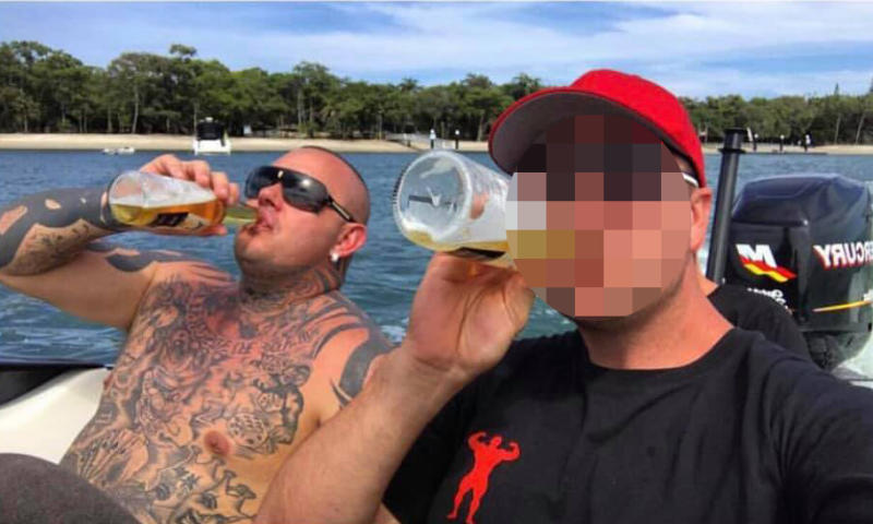Shane Ross, left, pictured enjoying a day on the water with a mate. Source: Facebook