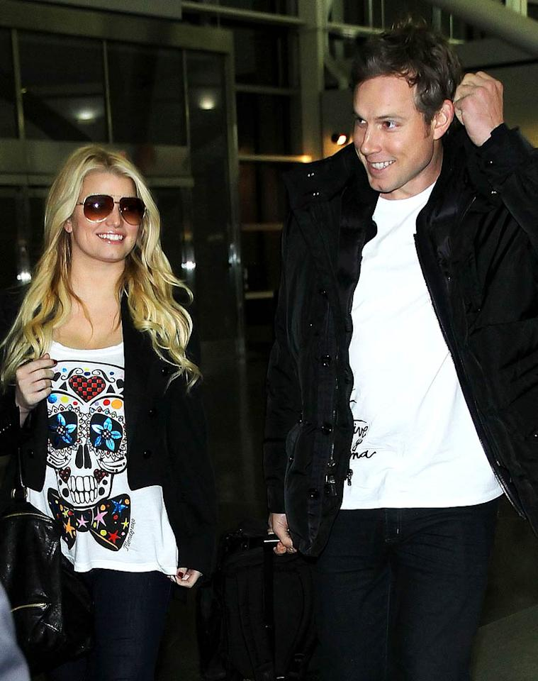 """""""Could Jessica Simpson ring in 2011 as a married woman?"""" asks <i>Us Weekly</i>. The magazine reports Simpson and fiance Eric Johnson """"are considering a New Year's Eve wedding,"""" and that the singer/actress would like to exchange vows in Cabo San Lucas, Mexico. To read what an insider has to say about Simpson's quickie wedding preparations, log on to <a href=""""http://www.gossipcop.com/jessica-simpson-wedding-new-years-eve-cabo-san-lucas-mexico-eric-johnson/"""" target=""""new"""">Gossip Cop</a>. Jackson Lee/<a href=""""http://www.splashnewsonline.com"""" target=""""new"""">Splash News</a> - December 1, 2010"""