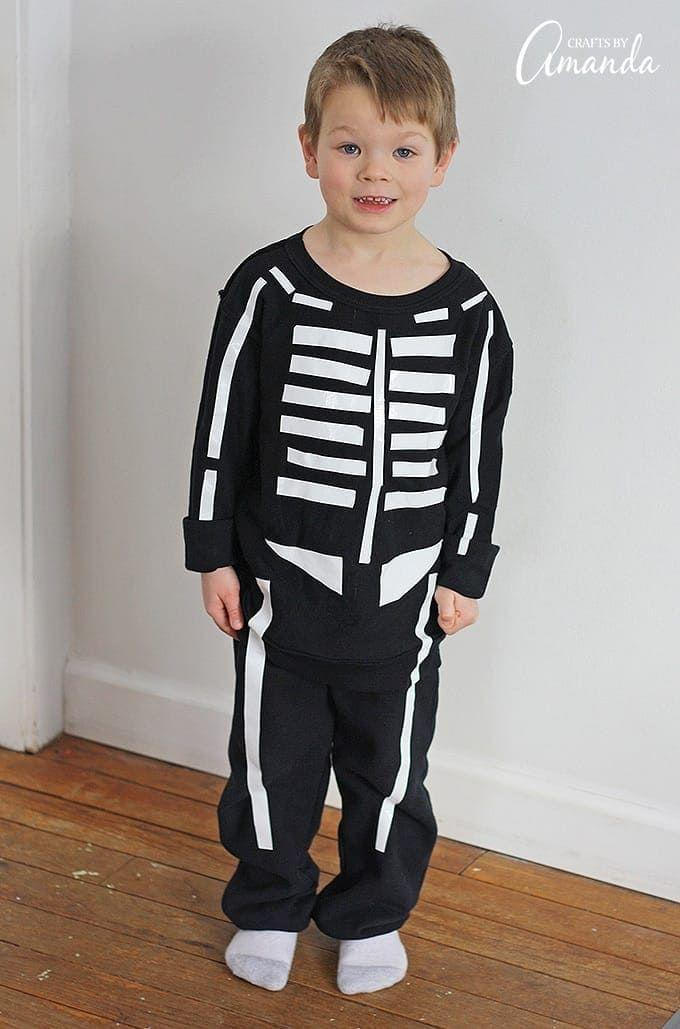 """<p>Make no bones about it, this costume—which can come together in mere minutes—is great for kids and adults alike! For added chills and thrills, use duct tape that glows in the dark.</p><p><strong>Get the tutorial at <a href=""""https://craftsbyamanda.com/duct-tape-skeleton-costume/"""" rel=""""nofollow noopener"""" target=""""_blank"""" data-ylk=""""slk:Crafts by Amanda"""" class=""""link rapid-noclick-resp"""">Crafts by Amanda</a>.</strong></p><p><a class=""""link rapid-noclick-resp"""" href=""""https://go.redirectingat.com?id=74968X1596630&url=https%3A%2F%2Fwww.walmart.com%2Fip%2FDuck-Brand-Glow-in-the-Dark-Mini-Duct-Tape-Roll-72%2F25291728&sref=https%3A%2F%2Fwww.countryliving.com%2Fdiy-crafts%2Fg23785711%2Flast-minute-halloween-costumes%2F"""" rel=""""nofollow noopener"""" target=""""_blank"""" data-ylk=""""slk:SHOP DUCT TAPE"""">SHOP DUCT TAPE</a></p>"""