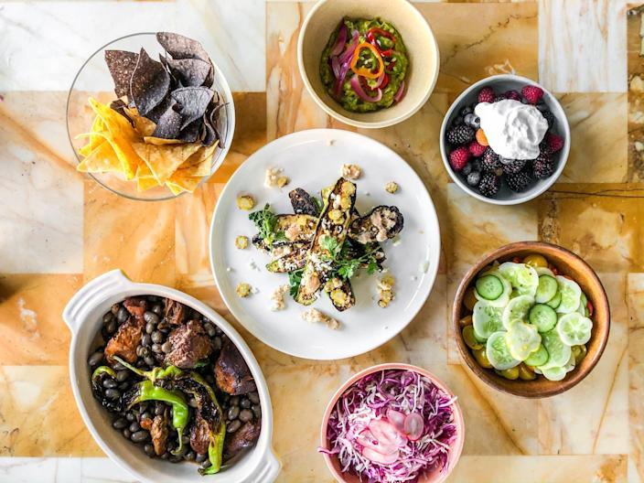 "Achiote pork, grilled squash and baby corn with cotija and other dishes from Farm Direct, a delivery and takeout service. <span class=""copyright"">(Bill Addison / Los Angeles Times)</span>"