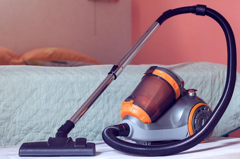 The vacuum challenge involves getting into a bin bag and sucking out the air with the vacuum attachment [Photo: Getty]