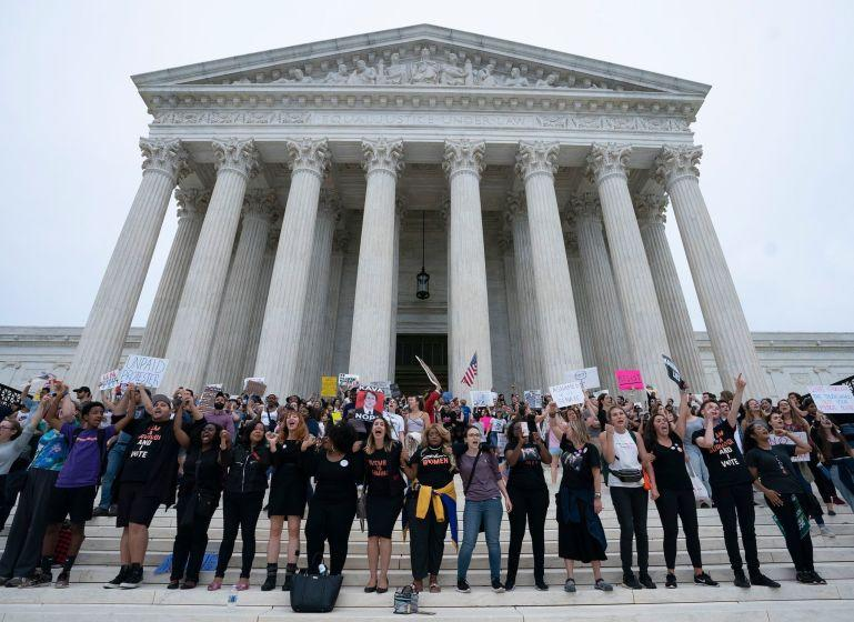 Protesters demonstrate outside the Supreme Court in Washington, DC in opposition to the Senate confirmation of Brett Kavanaugh to the court, October 6, 2018. (Photo by CHRIS KLEPONIS / AFP)CHRIS KLEPONIS/AFP/Getty Images ** OUTS - ELSENT, FPG, CM - OUTS * NM, PH, VA if sourced by CT, LA or MoD **