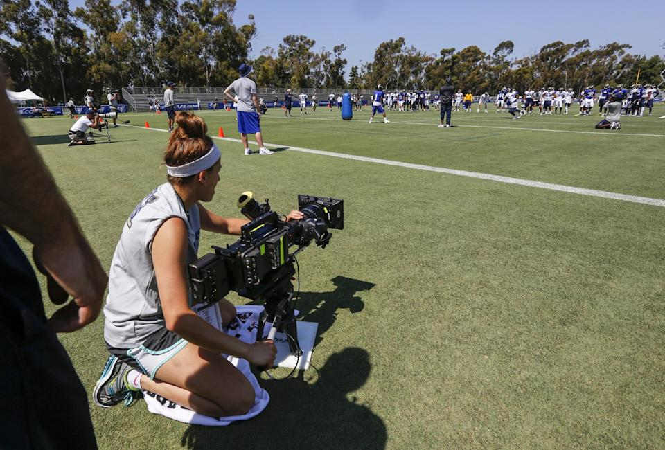 """The """"Hard Knocks"""" camera crew films a Rams practice in 2016."""