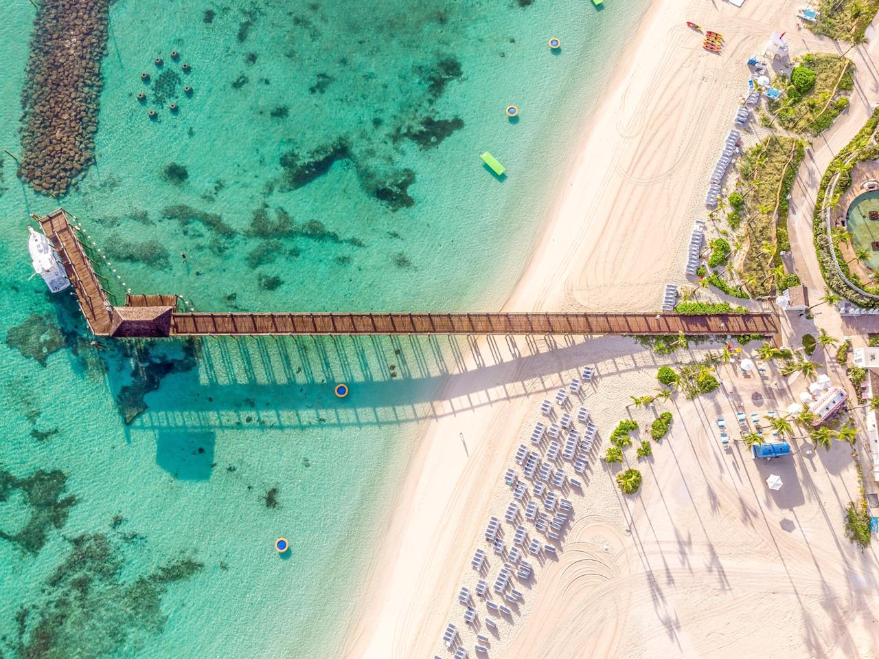 """<p><strong>Average winter temperatures:</strong> High of 77 degrees, low of 62 degrees</p> <p>East Coasters are lucky to have the perpetually sunny Caribbean in close proximity, and the <a href=""""https://www.cntraveler.com/readers-choice-awards/caribbean-atlantic/atlantic-top-resorts?mbid=synd_yahoo_rss"""" target=""""_blank"""">Bahamas</a>, with so many quick direct flights, is one of the region's best and most convenient options. (Although technically in the Atlantic, the crystal clear turquoise waters here are on par with anything found farther south.) This winter is a particularly great time to visit, as recovery efforts post-Hurricane Dorian are welcoming tourism dollars with open arms. Head to the island of Nassau for some of our favorite, unscathed properties, including <a href=""""https://www.cntraveler.com/hotels/nassau/sls-baha-mar?mbid=synd_yahoo_rss"""">SLS</a> and <a href=""""https://www.cntraveler.com/hotels/nassau/rosewood-baha-mar?mbid=synd_yahoo_rss"""">Rosewood</a> at the resort complex Baha Mar, as well as <a href=""""https://www.cntraveler.com/story/swimwear-designer-marysia-reeves-guide-to-the-bahamas?mbid=synd_yahoo_rss"""">Harbour Island</a>.</p>"""