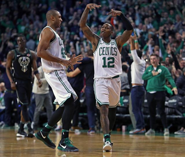 BOSTON, MA - APRIL 15: Boston Celtics Terry Rozier celebrates after making a three pointer with .5 seconds left in the fourth quarter to give Boston a 99-96 lead. Teammate Al Horford is at left. The Boston Celtics hosted the Milwaukee Bucks in Game One of an Eastern Conference First Round NBA Playoff basketball game at TD Garden in Boston on April 15, 2018. (Photo by Jim Davis/The Boston Globe via Getty Images)