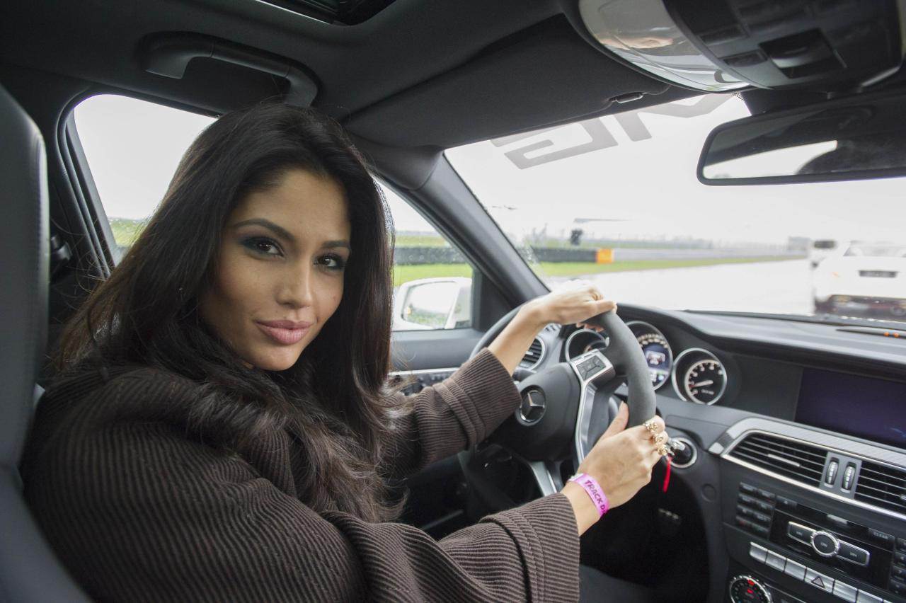 Miss Spain 2013 Patricia Yurena Rodriguez poses for a photo in a car at Moscow Raceway October 28, 2013. Miss Universe will be held at Crocus City Hall in Moscow on November 9. REUTERS/Darren Decker/Miss Universe Organization/Handout via Reuters (RUSSIA - Tags: SOCIETY ENTERTAINMENT TRANSPORT) ATTENTION EDITORS - NO SALES. NO ARCHIVES. FOR EDITORIAL USE ONLY. NOT FOR SALE FOR MARKETING OR ADVERTISING CAMPAIGNS. THIS IMAGE HAS BEEN SUPPLIED BY A THIRD PARTY. IT IS DISTRIBUTED, EXACTLY AS RECEIVED BY REUTERS, AS A SERVICE TO CLIENTS