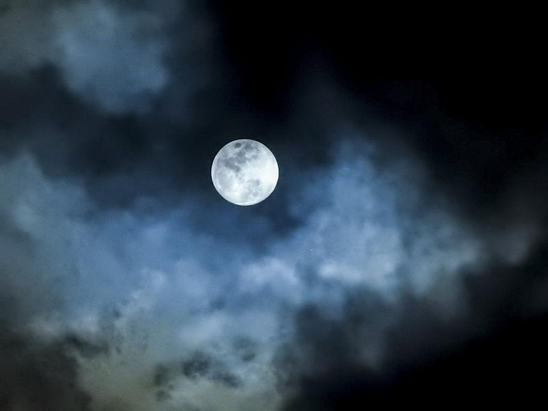 8d9f317e2 White blue in color, up close very detailed features of a full moon against  a