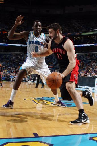 NEW ORLEANS, LA - FEBRUARY 29: Linas Kleiza #11 of the Toronto Raptors goes to the basket against Al-Farouq Aminu #0 of the New Orleans Hornets during the game on February 29, 2012 at the New Orleans Arena in New Orleans, Louisiana. (Photo by Layne Murdoch/NBAE via Getty Images)