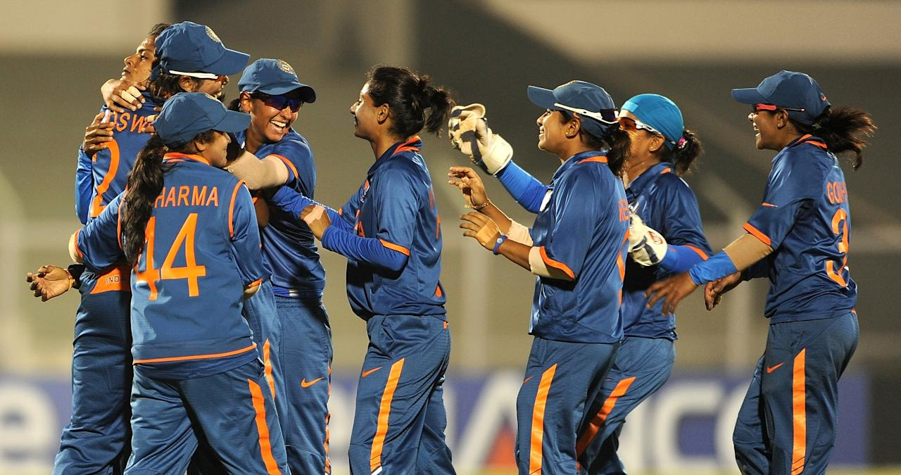 Indian cricketer Niranjana Nagarajan (L) is congratulated by teammates after taking the wicket of West Indian cricketer Deandra Dottin during the inaugural match of the ICC Women's World Cup 2013 between India and West Indies at the Cricket Club of India's Brabourne stadium in Mumbai on January 31, 2013.  AFP PHOTO/Indranil MUKHERJEE        (Photo credit should read INDRANIL MUKHERJEE/AFP/Getty Images)