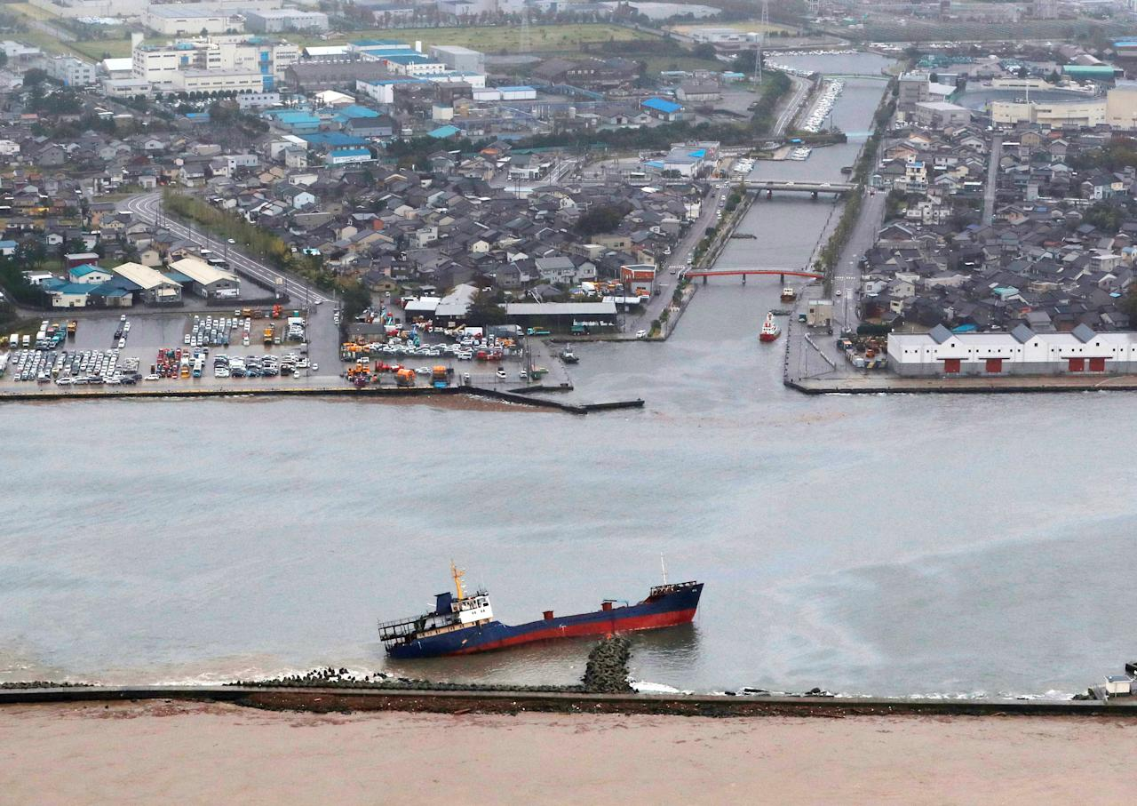 A listing cargo ship which ran onto a breakwater earlier, amid strong wind caused by Typhoon Lan, is seen at a port in Toyama prefecture, Japan in this photo taken by Kyodo on October 23, 2017. Mandatory credit Kyodo/via REUTERS ATTENTION EDITORS - THIS IMAGE WAS PROVIDED BY A THIRD PARTY. MANDATORY CREDIT. JAPAN OUT. NO COMMERCIAL OR EDITORIAL SALES IN JAPAN.