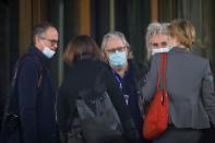 Members of the World Health Organisation (WHO) team tasked with investigating the origins of the coronavirus (COVID-19) pandemic, talk outside their hotel after returning from their second field trip in Wuhan