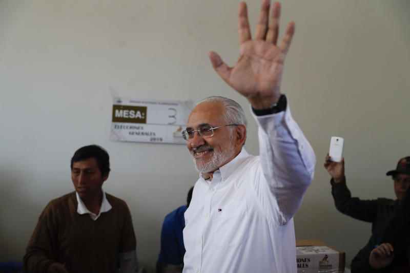 Opposition presidential candidate Carlos Mesa waves before voting during general elections in Mallasilla, in the outskirts of La Paz, Bolivia, Sunday, Oct. 20, 2019. Former president Mesa is the closest rival to President Evo Morales, who is seeking a fourth term in the country's general elections. (AP Photo/Jorge Saenz)