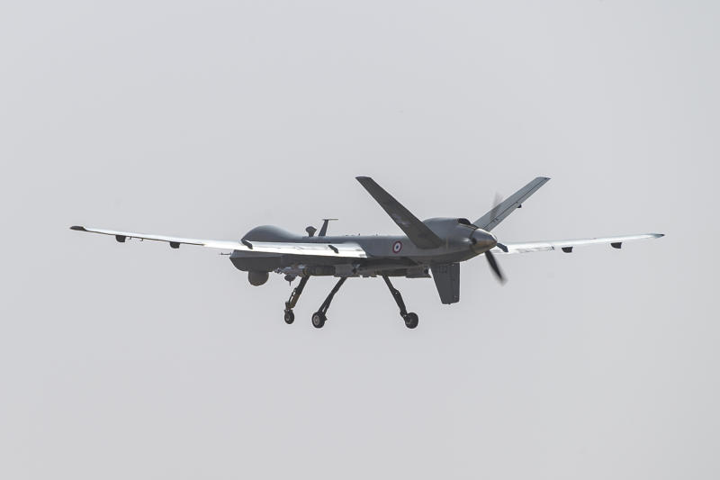 This photo provided by the French Defense Ministry communication center and taken Tuesday Dec. 17, 2019, shows a French Reaper drone with two GBU 12 missiles flying over Niamey airbase, Niger. France's defense ministry said Monday that it had carried out its first armed drone strike, killing seven Islamic extremists in central Mali over the weekend. France joins a tiny group of countries that use armed drones, including the United States. (Malaury Buis/EMA/DICOD via AP)