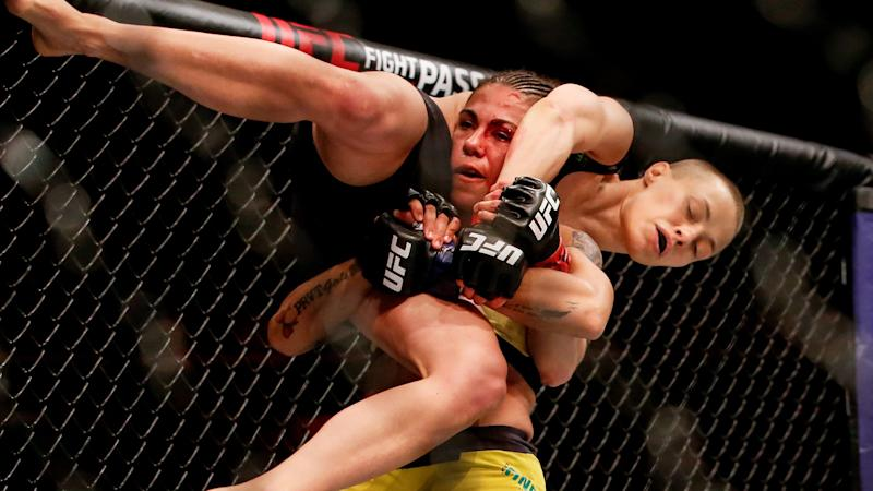 Jessica Andrade of Brazil attempts to slam Rose Namajunas of USA in their women's strawweight championship bout during the UFC 237 event at Jeunesse Arena on May 11, 2019 in Rio de Janeiro, Brazil. (Photo by Alexandre Schneider/Getty Images)