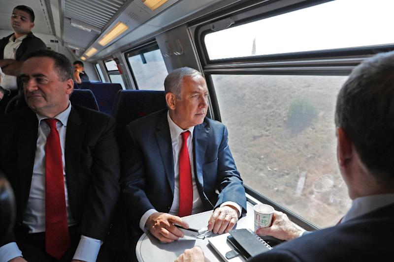 Israeli Prime Minister Benjamin Netanyahu (R) sits next to Israel's Transportation and Intelligence Minister Yisrael Katz during a test-run of the new high-speed train between Jerusalem and Tel Aviv on September 20, 2018