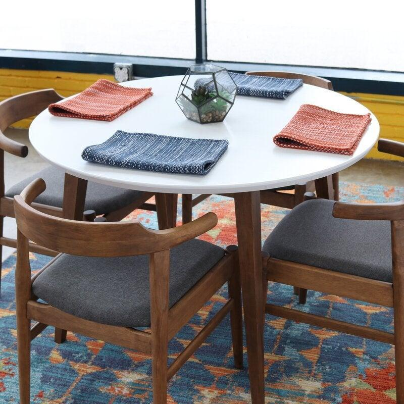 """<br><br><strong>George Oliver</strong> Keown Solid Wood Dining Table, $, available at <a href=""""https://go.skimresources.com/?id=30283X879131&url=https%3A%2F%2Fwww.wayfair.com%2Ffurniture%2Fpdp%2Fgeorge-oliver-keown-solid-wood-dining-table-w000497188.html"""" rel=""""nofollow noopener"""" target=""""_blank"""" data-ylk=""""slk:Wayfair"""" class=""""link rapid-noclick-resp"""">Wayfair</a>"""