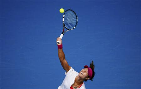 Li Na of China serves to Ekaterina Makarova of Russia during their women's singles match at the Australian Open 2014 tennis tournament in Melbourne